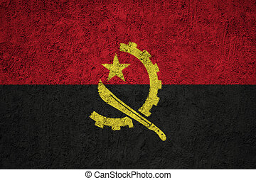 Angola flag painted on the cracked grunge concrete wall