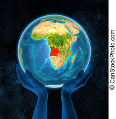 Angola on Earth in hands
