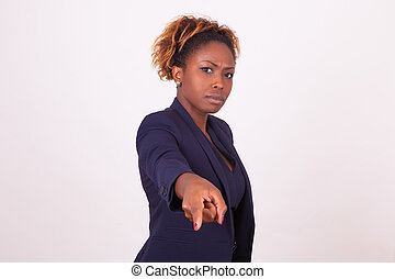 Angry African American business woman pointing finger to the screen