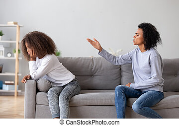 Angry aggressive mother scolding teen daughter at home