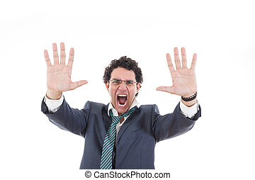 angry and shocked businessman holding invisible wall