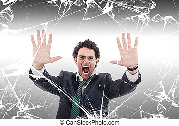angry and shocked businessman holding broken glass wall