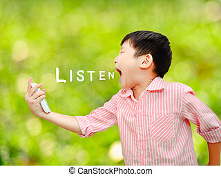 Angry Asian child shouting At Mobile Phone with bokeh background