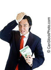 Angry Asian Man Holding Crumpled Stock Certificate Hand on Head