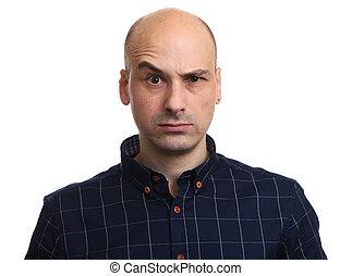Angry bald man looking at camera. Isolated