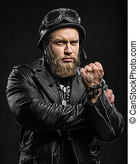 Angry Bearded Biker Man in Leather Jacket and Helmet over...