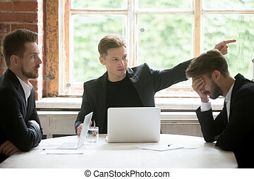Angry boss firing employee with hand gesture at office...