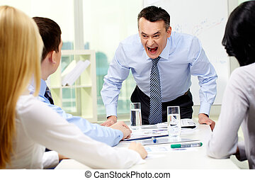 Angry boss - Angry businessman shouting at his workers with...