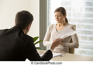Angry boss scolding scared female employee