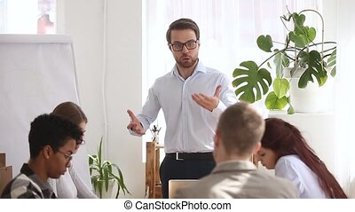 Angry boss shouting at group office meeting scolding...