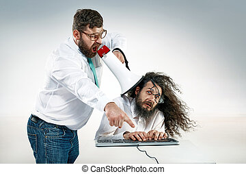 Angry boss yelling to an office worker