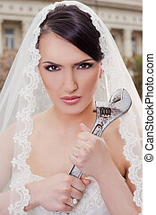 Angry bride hodling wrench