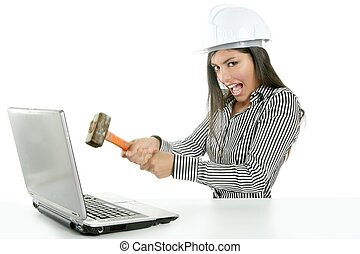 Angry brunette businesswoman with hammer