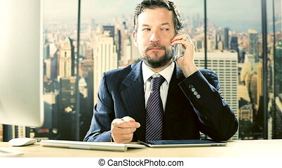Angry business man getting furious on the phone