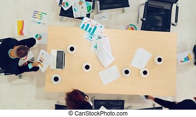 Angry business people with big problem at meeting table, ...