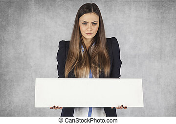angry business woman holds a place for your ad