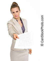 Angry business woman showing document