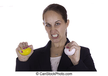 Angry business woman with stress balls