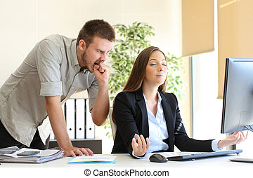 Angry businessman and relaxed businesswoman