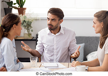 Angry businessman arguing with female subordinate at group meeting. Dissatisfied executives having conflict about paperwork failure, bad work results, default in duties. Business conflict concept