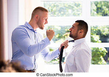 Angry Businessman Fighting With His Coworker