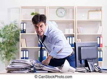 The angry businessman frustrated with too much work