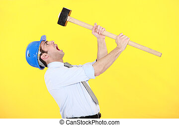 angry businessman holding a hammer