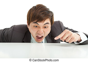 angry businessman pointing something on the table