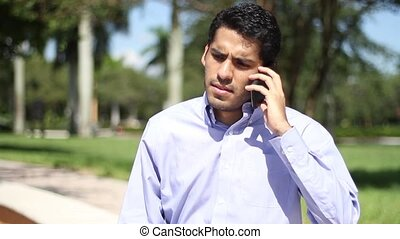 Angry businessman talking. phone