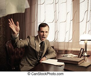 Angry businessman throwing a documents