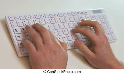 angry businessman typing on a keyboard