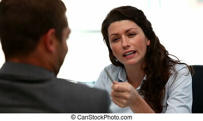 Angry businesswoman during meeting with a businessman