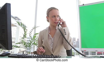 Angry businesswoman ending a call
