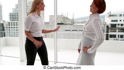 Angry businesswoman having a fight