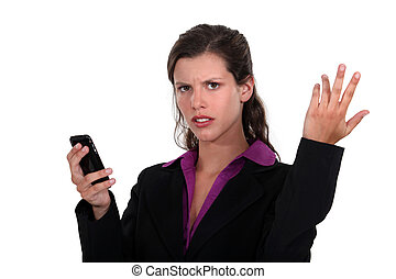 angry businesswoman holding a cell