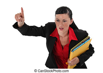 Angry businesswoman holding documents