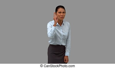 Angry businesswoman pointing on grey screen in slow motion
