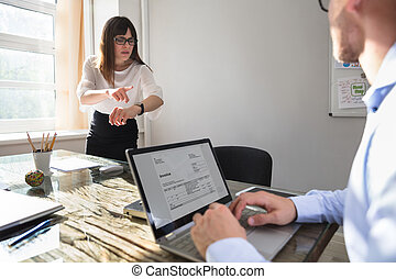 Angry Businesswoman Pointing On Wrist Watch