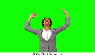 Angry businesswoman raising arms on green screen in slow...