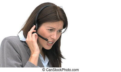 Angry businesswoman talking with headphones isolated on a...