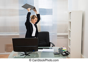 Angry Businesswoman Throwing Laptop