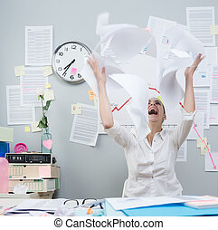 Angry businesswoman throwing paperwork in air - Angry...