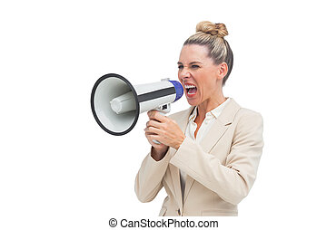 Angry businesswoman using megaphone