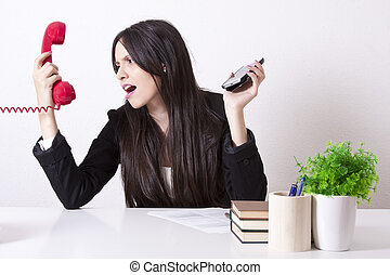angry businesswoman with phone cord and mobile