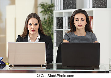 Angry businesswomen looking with hate - Front view of two...