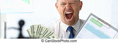 Angry businness vlogger hold in hands dollars and financial statistics chart portrait. Financial freedom concept