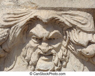 angry carved stone face
