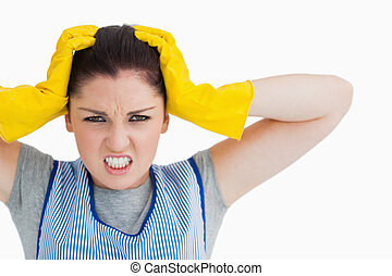 Angry cleaning woman looking at camera
