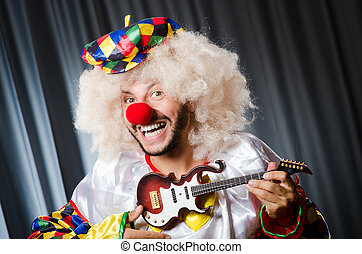Angry clown with guitar in funny concept