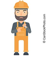 Angry constructor pointing at wrist watch. - Angry caucasian...